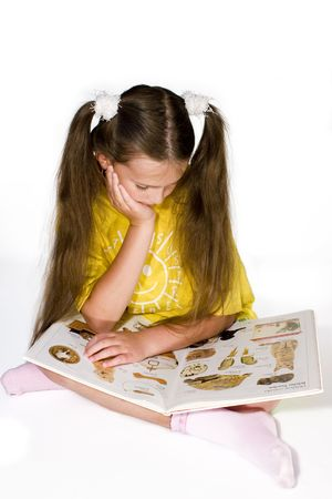 Young girl reading a  picture book photo