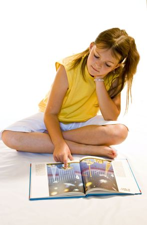 encyclopedias: Young girl reading a book