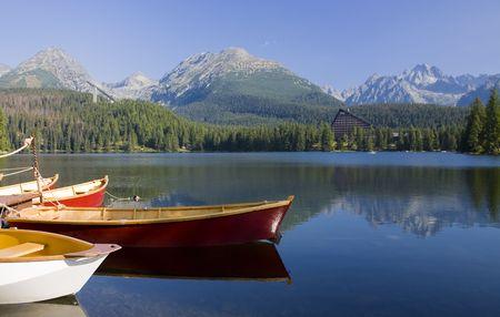 tatra: Mountain lake with  boats in National Park High Tatra, Slovakia