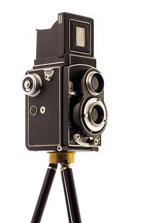 tripod: Vinatage Camera on tripod over white background Stock Photo