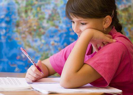 Young girl doing his homework photo