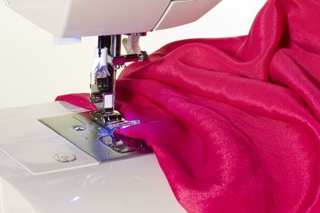 making dresses: Close up of sewing machine