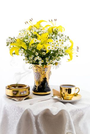 Flower still life with coffee  cup photo