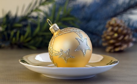 small plate: Golden Christmas ball on small plate