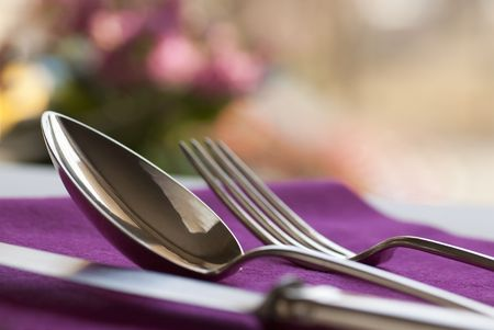 receptions: A knife, a spoon, and a fork on table Stock Photo