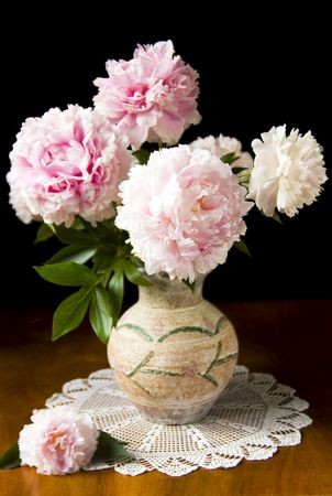 Still-life with pink peony in vase photo