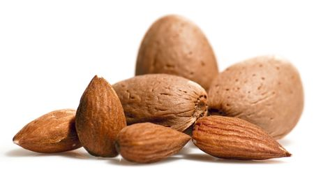 Almonds close up isolated on white background photo