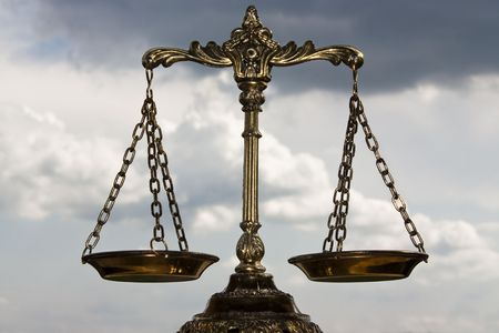 A photo of the scales of justice with a balance theme overlay photo