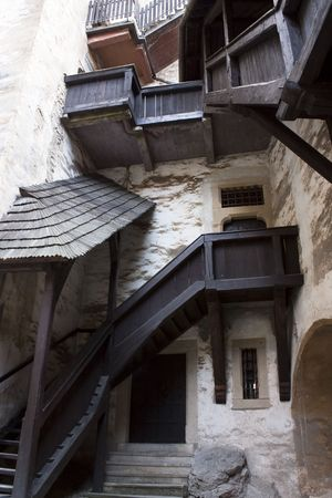 Exterior of old castle with woody stairs photo