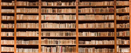 bookcase: Lots of old books in a old library Stock Photo