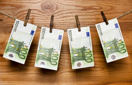 Euros hang on  old clothes-peg Stock Photo - 6701688