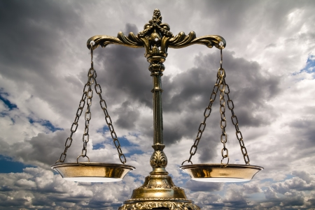 juror: A photo of the scales of justice with a balance theme overlay Stock Photo