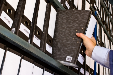 document management: Shelf with Folders for documents