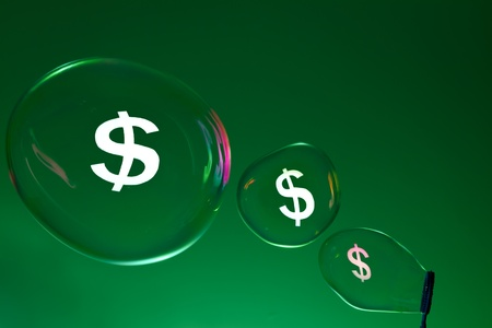 Bubbles and dollar sign. Financial Concept. photo