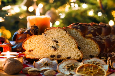 traditon: Christmas still life with cake and candles Stock Photo