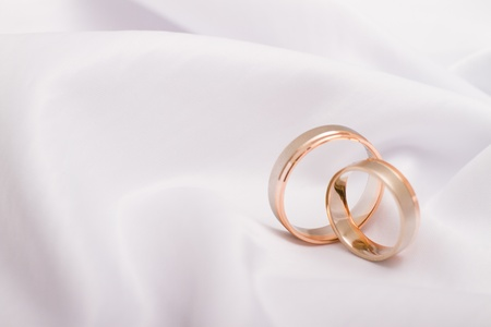 Wedding rings on a white background photo