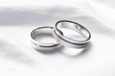 wedding symbol: Two weddings rings on a background a fabric