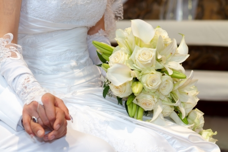 Wedding Day Bride and Grooms hands With Wedding Bouquet photo