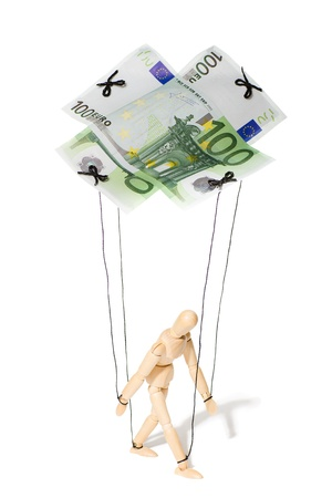 concept, a puppet controlled by money photo