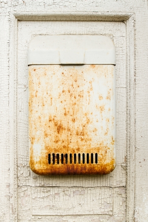 Old white wall with mailbox photo