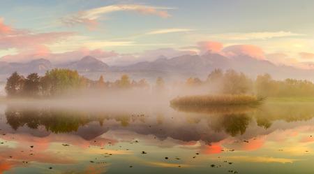 fall landscape: Beautiful Autumn Fall landscape over foggy misty lake