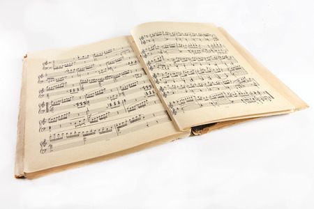 assembly hall: Retro Old  music notes album on a white background Stock Photo