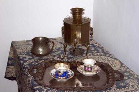 samovar: Tea party with Russian samovar tea set tableware 19th century.