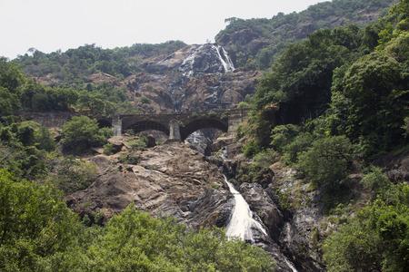 periyar: Waterfall in the jungle, a beautiful view of the railway on  cliff .Indiya Goa. Stock Photo
