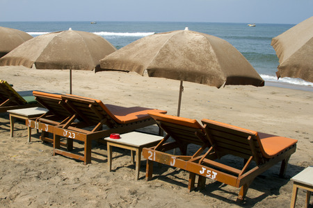sunshades: Plank beds and sunshades on a beach. India Goa.