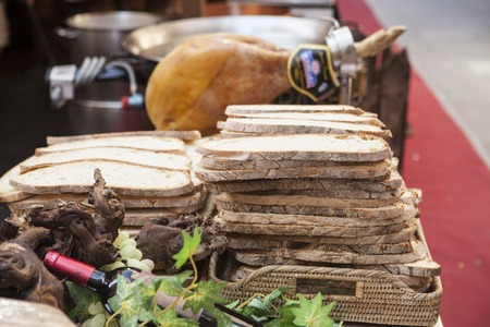 hoagie: The bread slices, fresh vegetables wine ham at a fair in Spain. Stock Photo