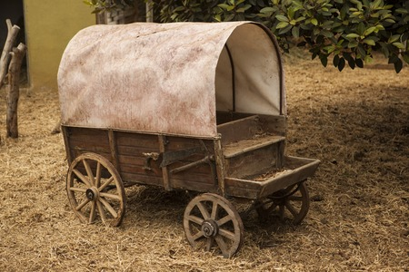 old wood farm wagon: Traditional old American wagon with a roof. Wild west traditonal vintage old wagon  detail.