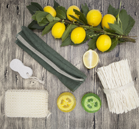 handmade soap: Set for spa handmade soap sponge lemon  towel mirror perfume grass on wooden background.