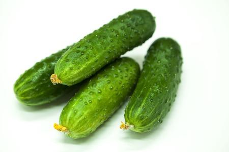 cuke: Fresh appetizing tasty cucumbers on a white background