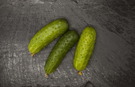 cuke: Fresh appetizing tasty cucumber on a stone background