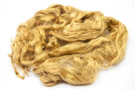 sheep wool: Saffron piece of Australian sheep wool Merino breed close-up on a white background.