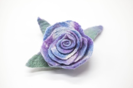 milled: Beautiful blue rose flower milled wool on a white background