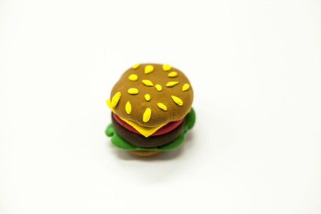 caf: Juicy burger plasticine close-up on a white background, an icon for the Internet, cafe, restaurant.