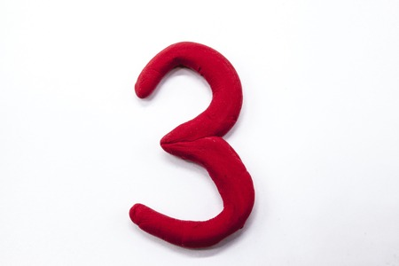 Red plasticine figure number three 3 close-up on a white background. The icon for the Internet