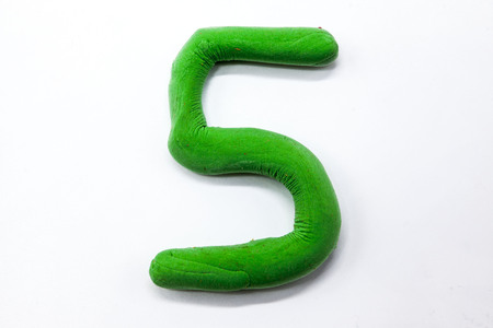 monotype: Green plasticine figure number five 5 close-up on a white background. The icon for the Internet