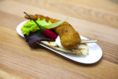 tiger shrimp: Thai grilled tiger shrimp on a slice of baguette, white with red chili peppers and lettuce. Spanish fresh delicious tapas Stock Photo
