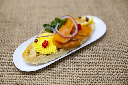 excellent background: Fresh Spanish tapas on bread baguette smoked Norwegian salmon with black olive butter, herbs and onions. An excellent background for the menus, the restaurant, the Cafe Mediterranean cuisine