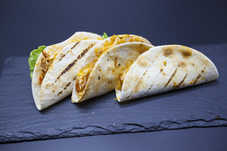 tex mex: Mexican Tortilla with meat beef and stewed vegetables and spicy sauce