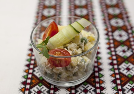 glass bowl: Traditional Russian fresh salad  olivier in a glass bowl