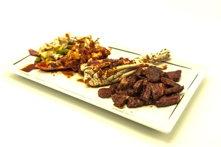 stake: Surf and turf, fried lobster and juicy stake with a garnish from fried vegetables