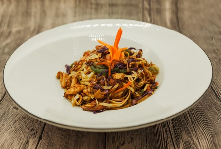 hoisin: Fried Chinese noodles with vegetables and a cauliflower and chicken