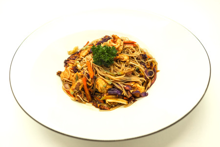 hoisin: Fried Chinese noodles with vegetables and a cauliflower and with pork and shrimps Stock Photo