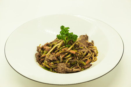 hoisin: Fried Chinese noodles with vegetables and a cauliflower and with beef. Stock Photo