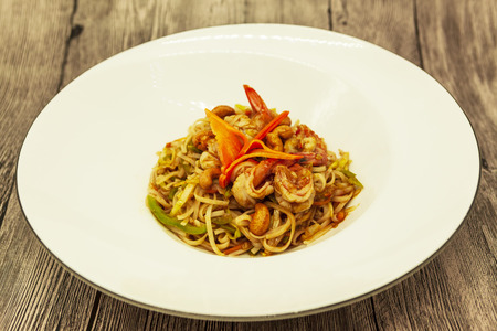 hoisin sauce: Fried Chinese noodles with vegetables and a cauliflower and with seafood Stock Photo