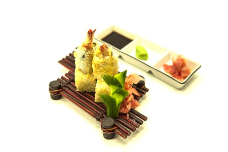 tiger shrimp: Set of fresh sushi with the Norwegian salmon and a cucumber and fried tiger shrimp.