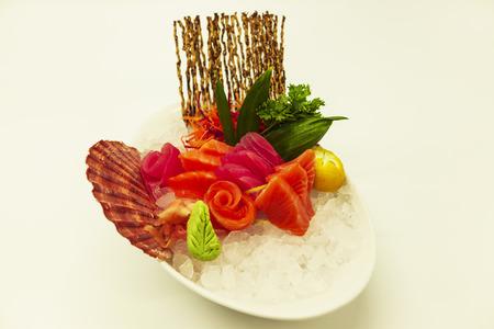 ova: Set of sashimi with the Norwegian salmon and the Atlantic tuna on ice with a fresh Sicilian lemon